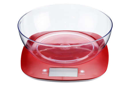 A red plastic electronic scale with a transparent measuring cup isolated on white background.