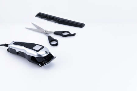 Electric hand-held hair clipper with accessory  for hair salon or barber shop on the white background with copy space Foto de archivo