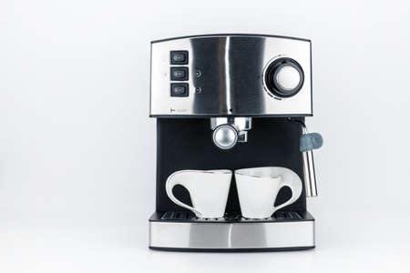 Espresso coffee machine with steam jet on the white background with copy space Foto de archivo