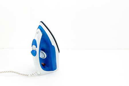 Electrical blue and white iron on the white mat background