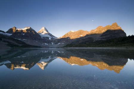 assiniboine: mountain range reflection in assiniboine provincial park  Stock Photo