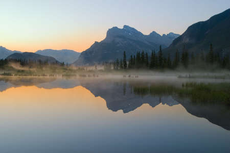 vermillion lake with mount rundle and reflection at dawn photo