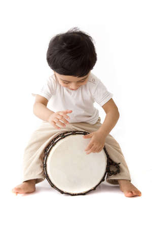 drumming: toddler boy playing drums