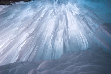 icefall: icefall from behind,frozen waterfall shot with tripod, backlit by natural light