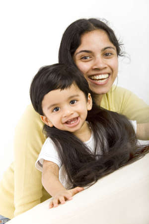 indian happy family: mom with very long hair and toddler Stock Photo