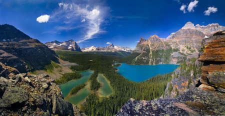 beautiful mountain lakes in canadian rockies on a sunny day, backcountry lake ohara,blue sky,color photo