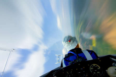 pilot in sailplane, flying