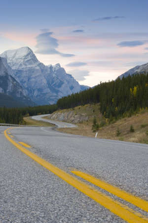 curving road winding through mountain landscape photo