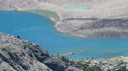 glacial lake in candian rockies surrounded by bare scree rocks