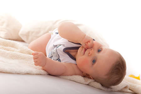 baby boy 7 months old, lying on belly Stock Photo - 9425025