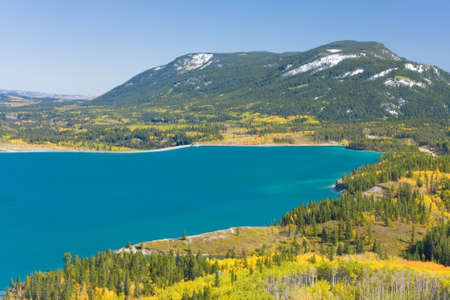 turquoise barrier lake in fall, yellow aspen, canadian rockies Stock Photo - 9442371