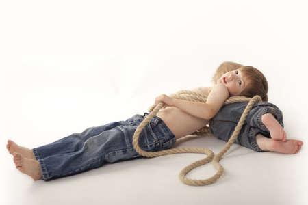 bonding rope: boys lying on floor,white background,fettered with rope