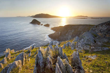 view of irish west coast towards blasket islands at sunset Stock Photo