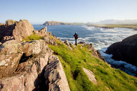 man enjoying ocean view,ireland Stock Photo
