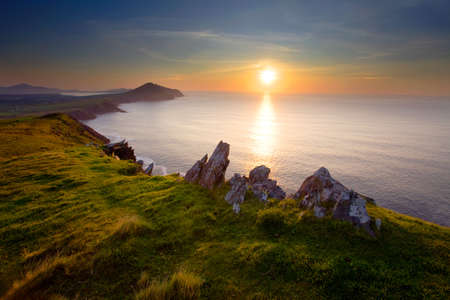 scenic ocean view of western irelands coastline on dingle,hdr,sunset