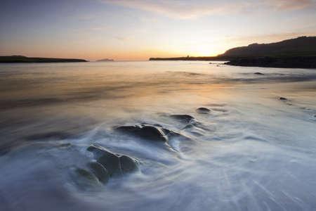 blasket islands: waves rolling on beach at twilight,blasket islands,ireland,long exposure,high dynamic range image