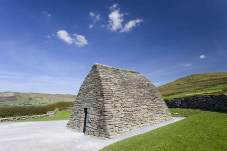 touristic medieval gallarus oratory, some clouds, blue sky