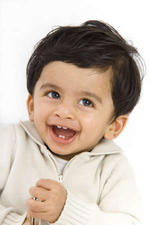 portrait of indian toddler boy laughing, fun, white photo