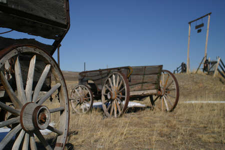 old wooden wagons in rocky mountain foothills photo