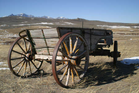 foothills: old wooden wagons in rocky mountain foothills