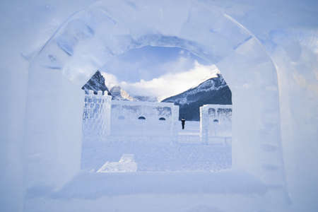 look through sculptured window of ice on ice castle and lake louise