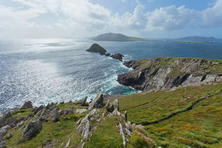 coastline: looking out towards blasket islands while sky is clearing up on midday
