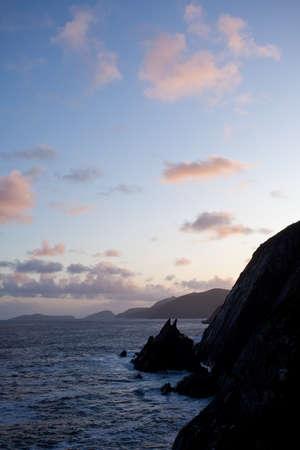 blasket islands: simple scene of cliffs silhouettes and clouds in twilight, dingle peninsula,ireland