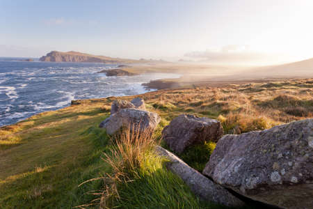 morning light illuminating dingle coast Stock Photo