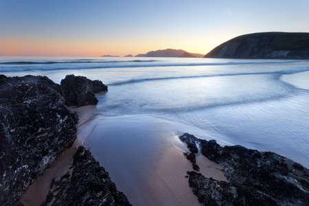 blasket islands: beach on irish west coast after sunset
