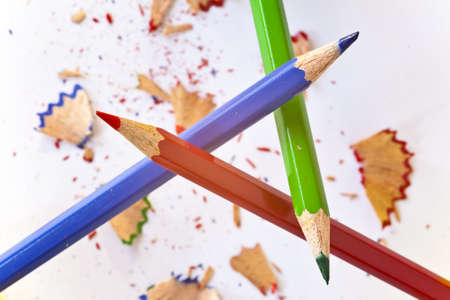 order and chaos, three pencils forming triangular with splinters below Stock Photo