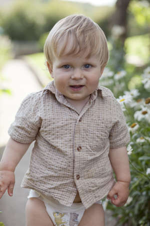 boy in garden with diapers Stock Photo - 13304425