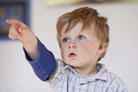 toddler pointing out with finger, inside Stock Photo - 13528234