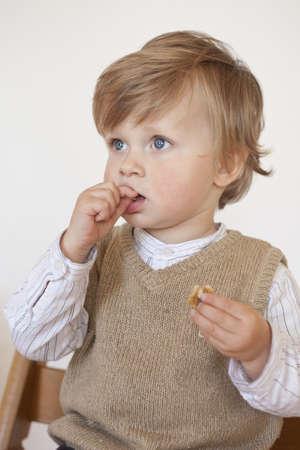 portrait of boy 1 year old looking sideways photo