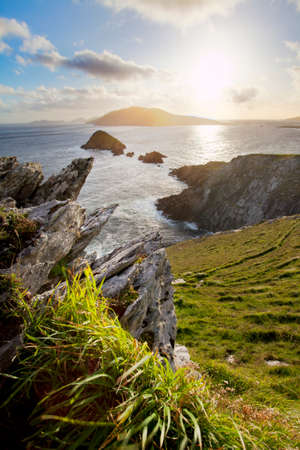 blasket islands: scenic irish west coast, looking from dingle peninsula  Europe s most westerly point  in western ireland towards blasket islands while the sky is clearing up.