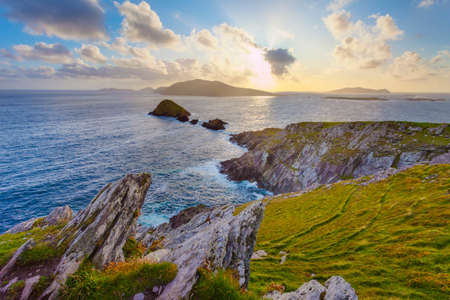 dunquin: Scenic Irish west coast, looking from dingle peninsula  Europe s most westerly point  in western Ireland towards blasket islands while the sky is clearing up, thirds of land water air.