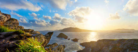 dunquin: scenic irish west coast, looking from dingle peninsula  Europe s most westerly mainland point  in western ireland towards blasket islands while the sky is clearing up.