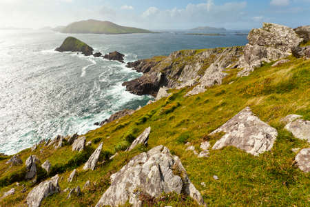 dunquin: Scenic Irish west coast, looking from dingle peninsula  Europe most westerly mainland point  in western Ireland towards Blasket islands while the sky is clearing up.