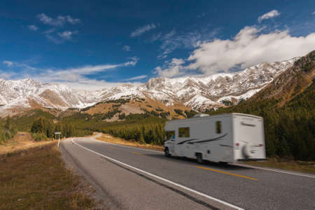 Camper driving on Highway 40  Kananaskis Trail  in Alberta, Canada, through Rocky Mountains, motion blured. Stock Photo