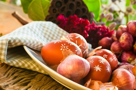 Naturally colored Easter eggs with onion skin and hand-painted