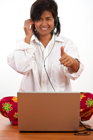 Isolated portrait of a happy young woman sitting on the floor and working on the notebook Stock Photo - 8873796
