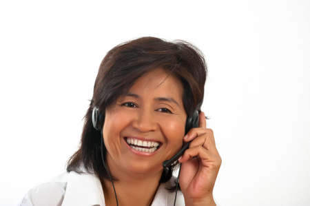 portrait of a happy smiling young Asian woman with a headset Stock Photo