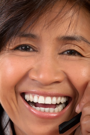portrait of a happy smiling young Asian woman photo