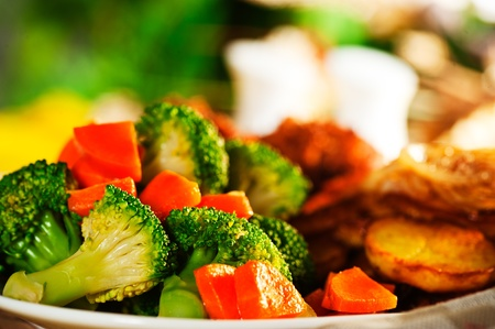 prepared: Fried potatoes broccoli carrots and roasted chicken Stock Photo