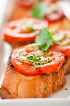 food buffet: Bruschetta - gold baked baguette with tomato garlic and basil as appetizer