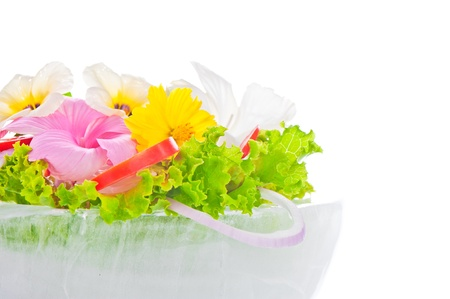 Green salad with tomatoes and various edible flowers in a bowl of ice on a white background Stock Photo - 11537064