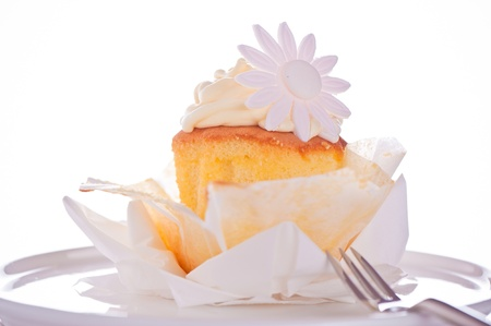 Cupcake with vanilla cream and sugar flower on a white background Stock Photo - 11537106