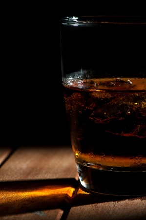 A glass of wiskey with ice photo
