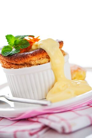 Cointreau or whiskey souffle with orange, mint and vanilla sauce on white background Stock Photo - 12601443