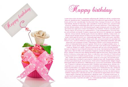 A beautiful pink happy birthday cupcake with flower and a label for your text on white background as studio shot photo