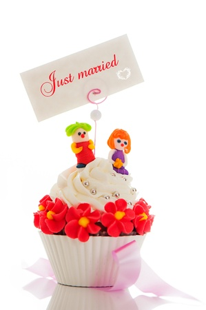 A wedding cupcake on white background as studio shot photo